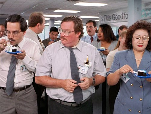 Milton from 'Office Space' does not receive any cake during the a birthday celebration. He looks on, forlornly, while everyone else in the office enjoys cake.