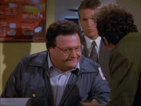 Newman, the mail-carrier character from Seinfeld, in uniform
