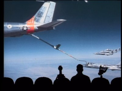 The crew of Mystery Science Theater 3000 watches planes refueling in the bold Air Force epic, the Starfighters